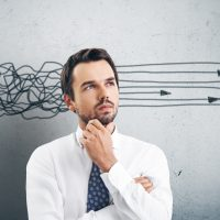 shutterstock_Thinking businessman_170661569